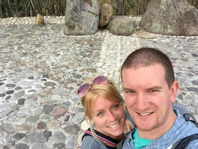 Cyn and Matt standing on the equator in Ecuador